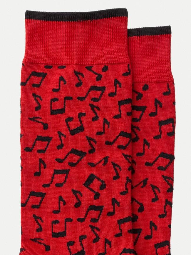 Chaussettes rouges à motifs en coton bio - olsson note - Nudie Jeans num 1